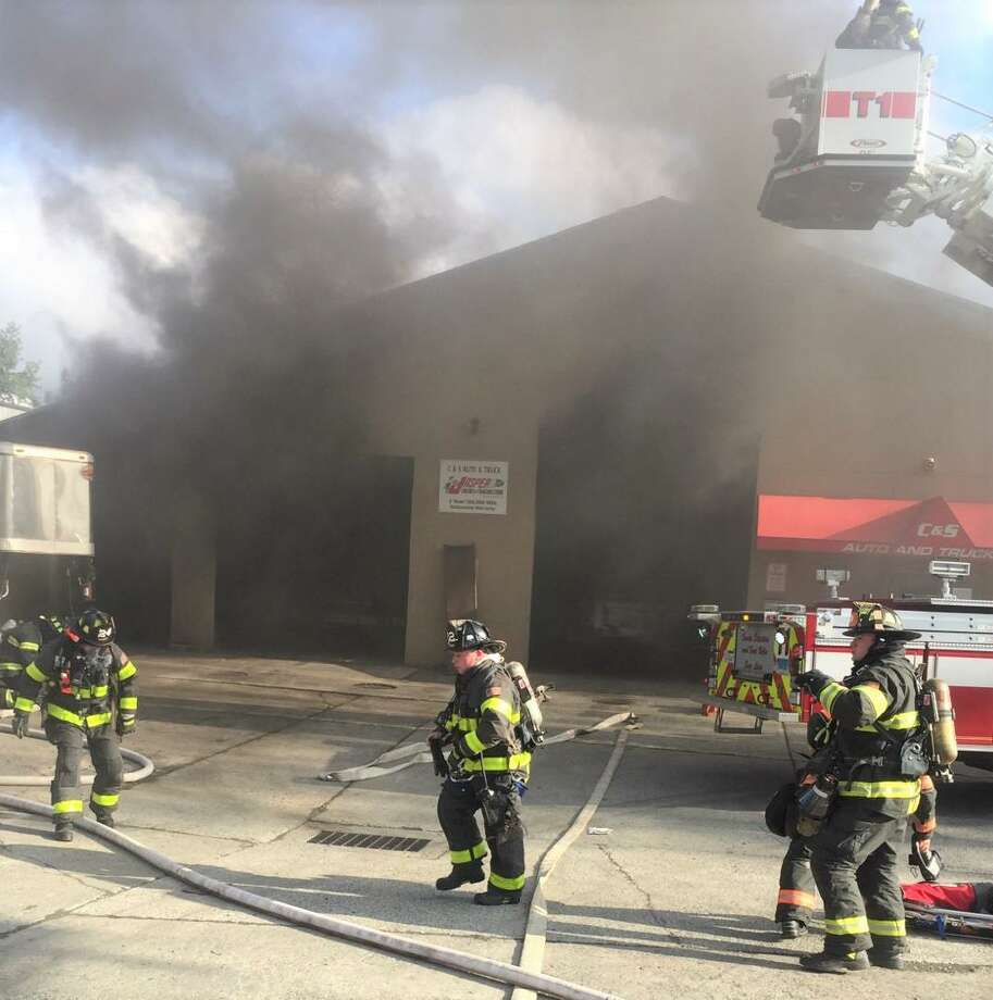 Danbury firefighters at an auto body garage fire on Shelter Rock Road Monday. Photo: Danbury Fire Department