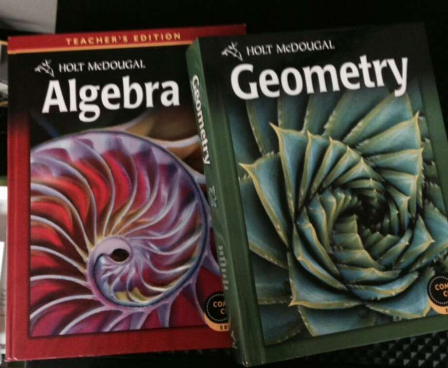 Algebra and geometry books like these are used in Bridgeport Public Schools. Photo: Linda Lambeck / Linda Lambeck / Connecticut Post