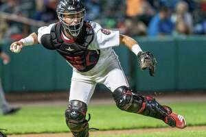 Tri-City ValleyCats catcher Nate Perry fields a ball in front of the plate during a game against the Hudson Valley Renegades at the Joseph L. Bruno Stadium in Troy NY on Friday, Aug. 23, 2019 (Jim Franco/Special to the Times Union.)