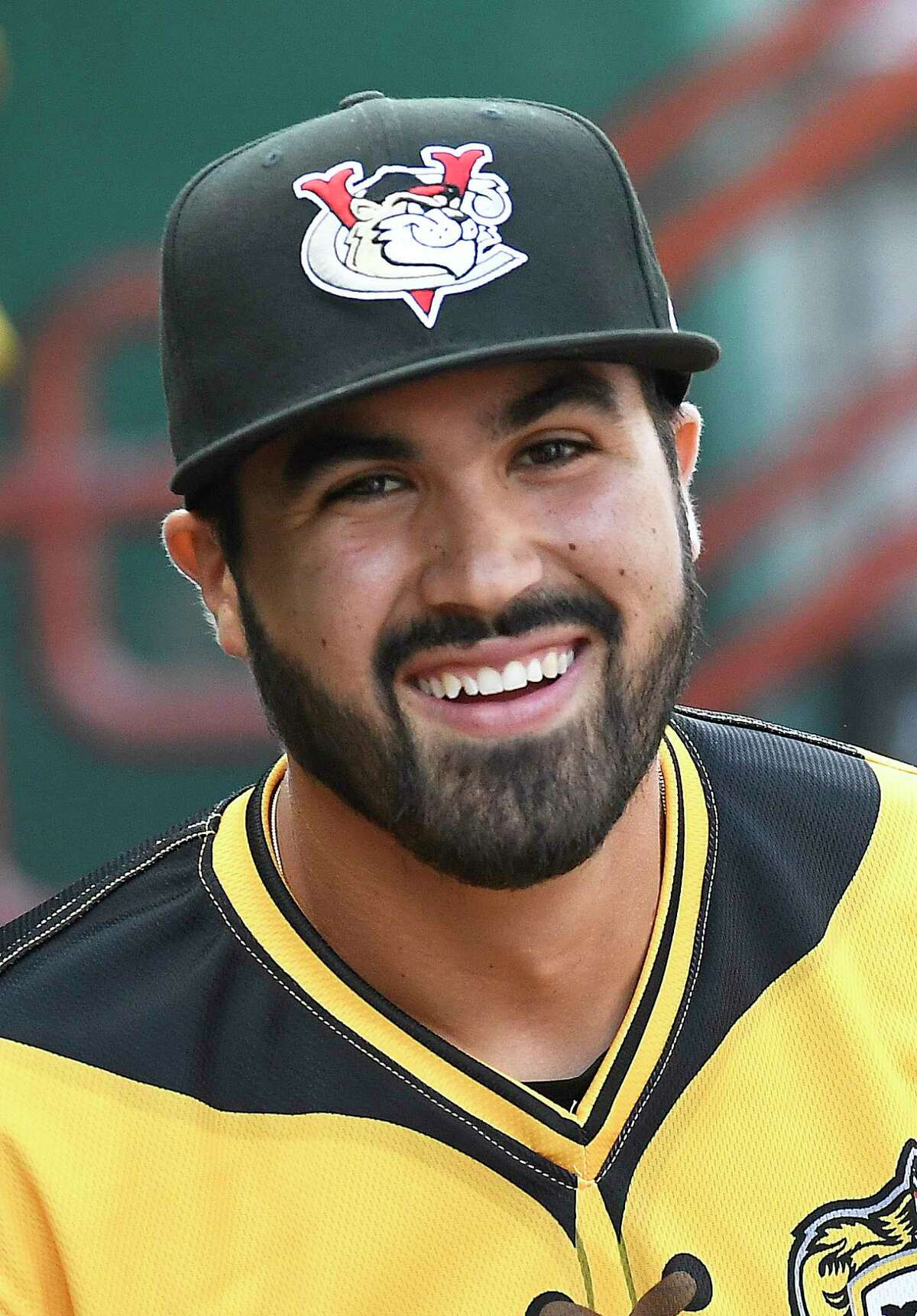 Tri-City ValleyCats manager Ozney Guillen (13) is seen in the dugout during a minor league baseball game against the State College Spikes Friday, July 12, 2019, in Troy, N.Y. (Hans Pennink / Special to the Times Union)