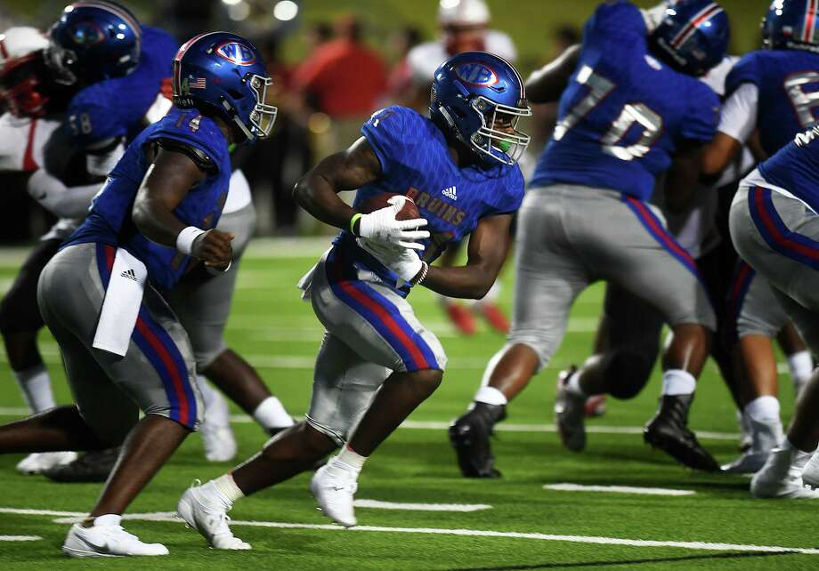 West Brook'sJevion Manuel runs the ball against Bellaire at Beaumont's Memorial Stadium Friday night.  Photo taken Friday, 8/30/19 Photo: Guiseppe Barranco/The Enterprise, Photo Editor / Guiseppe Barranco ©