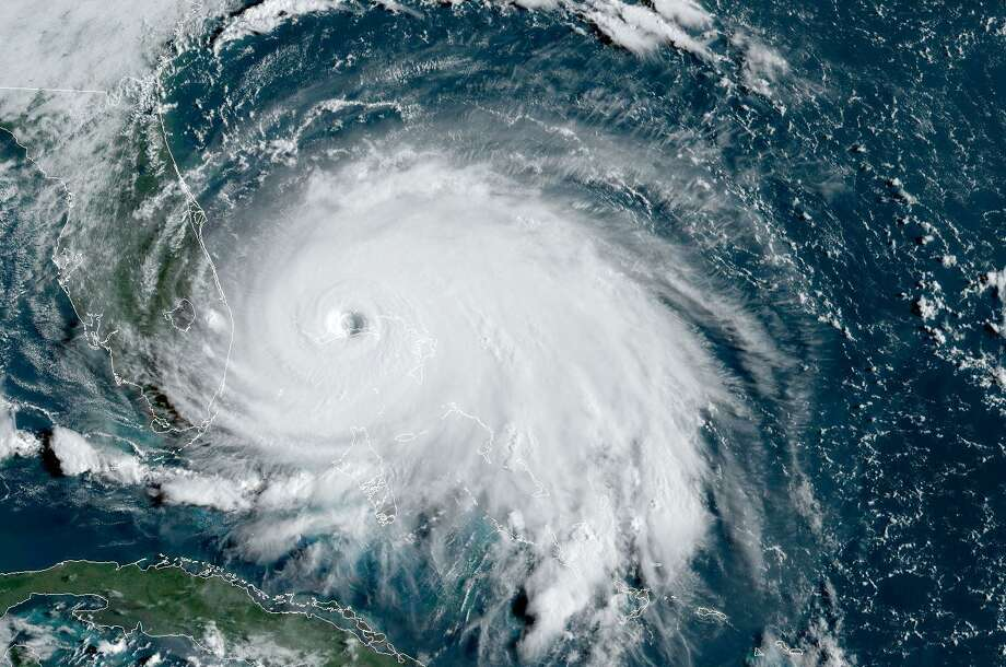 """TOPSHOT - This satellite image obtained from NOAA/RAMMB, shows Tropical Storm Dorian as it approaches the Bahamas at 13:00 UTC on September 2, 2019. - Hurricane Dorian battered the Bahamas with ferocious wind and rain on Sunday, the monstrous Category 5 storm wrecking towns and homes as it churned on an uncertain path toward the US coast where hundreds of thousands were ordered to evacuate. Packing sustained winds of 165 miles per hour (270 kph) with a towering 18 to 23 foot (5 to 7 metre) storm surge, Dorian crashed over the Abacos Islands, in the northwest Bahamas, as the strongest storm ever to hit the Caribbean chain. (Photo by NOAA / NOAA/RAMMB / AFP) / RESTRICTED TO EDITORIAL USE - MANDATORY CREDIT """"AFP PHOTO / NOAA/RAMMB/HANDOUT"""" - NO MARKETING - NO ADVERTISING CAMPAIGNS - DISTRIBUTED AS A SERVICE TO CLIENTSNOAA/AFP/Getty Images Photo: NOAA, Contributor / AFP/Getty Images / AFP or licensors"""