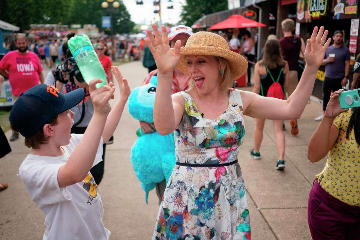 (FILES) In this file photo taken on August 10, 2019, Democratic presidential candidate Kirsten Gillibrand (R) and son Theodore visit the Iowa State Fair in Des Moines, Iowa. - Gillibrand announced on August 28, 2019, via a video on her twitter account she is dropping out of the 2020 Democratic presidential nomination. (Photo by ALEX EDELMAN / AFP)ALEX EDELMAN/AFP/Getty Images