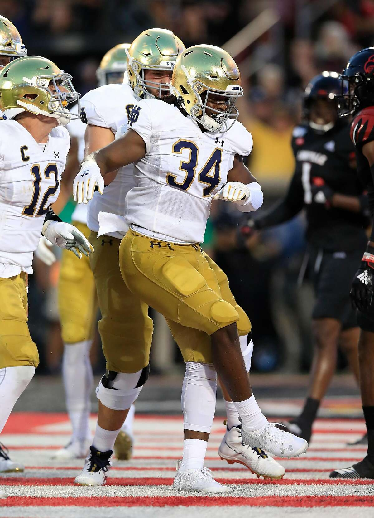 LOUISVILLE, KENTUCKY - SEPTEMBER 02: Jahmir Smith #34 of the Notre Dame Fighting Irish celebrates after scoring a touchdown against the Louisville Cardinals on September 02, 2019 in Louisville, Kentucky. (Photo by Andy Lyons/Getty Images)