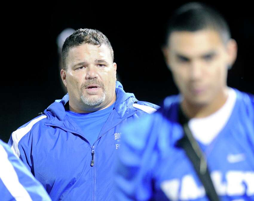 Hoosic Valley head coach Pete Porcelli ,left, instructs his players against Greenwich during their Section II Class C high school football championship game in Lansingburgh, N.Y., Friday, Nov. 6, 2015. (Hans Pennink / Special to the Times Union) ORG XMIT: HP102