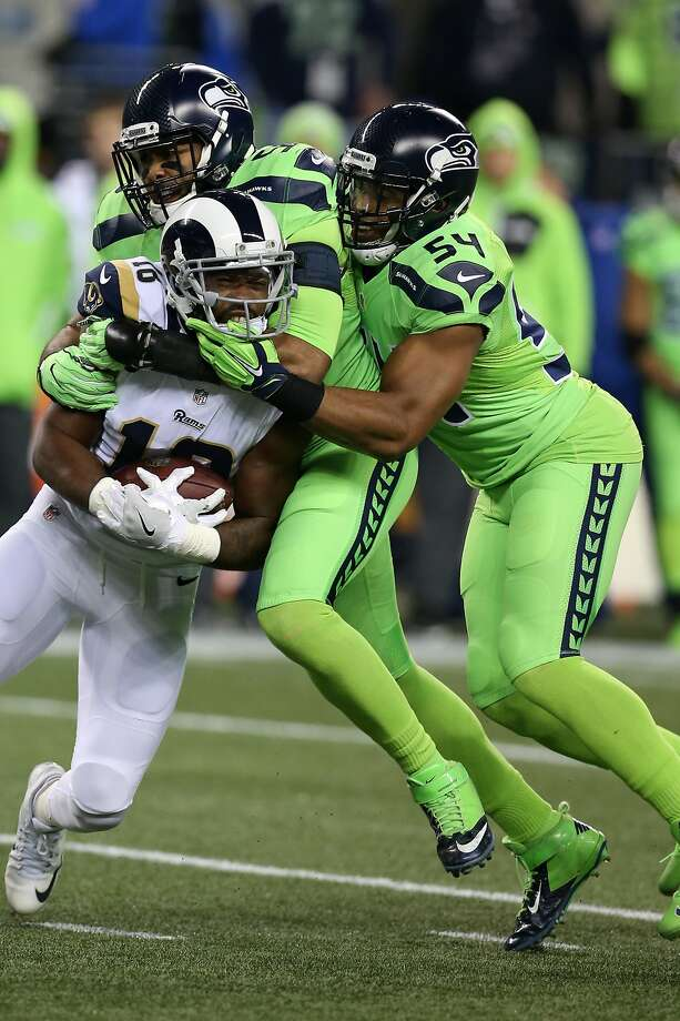 SEATTLE, WA - DECEMBER 15:  K.J. Wright #50 and Bobby Wagner #50 of the Seattle Seahawks tackle Pharoh Cooper #10 during the game against the Los Angeles Rams at CenturyLink Field on December 15, 2016 in Seattle, Washington.  The Seahawks defeated the Ram Photo: Rob Leiter / Getty Images