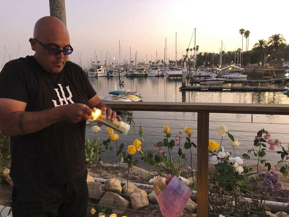 Orlando Aldana, 42, of Santa Barbara, bought 34 candles in honor of the victims to place at the growing memorial for those caught in the fire on the Conception boat, Monday, Sept. 2, 2019, in Santa Barbara, Calif. A fire raged through the boat carrying recreational scuba divers anchored near an island off the Southern California coast early Monday, leaving multiple people dead and hope diminishing that any of the more than two dozen people still missing would be found alive. (AP Photo/Stefanie Dazio) Photo: Stefanie Dazio, Associated Press