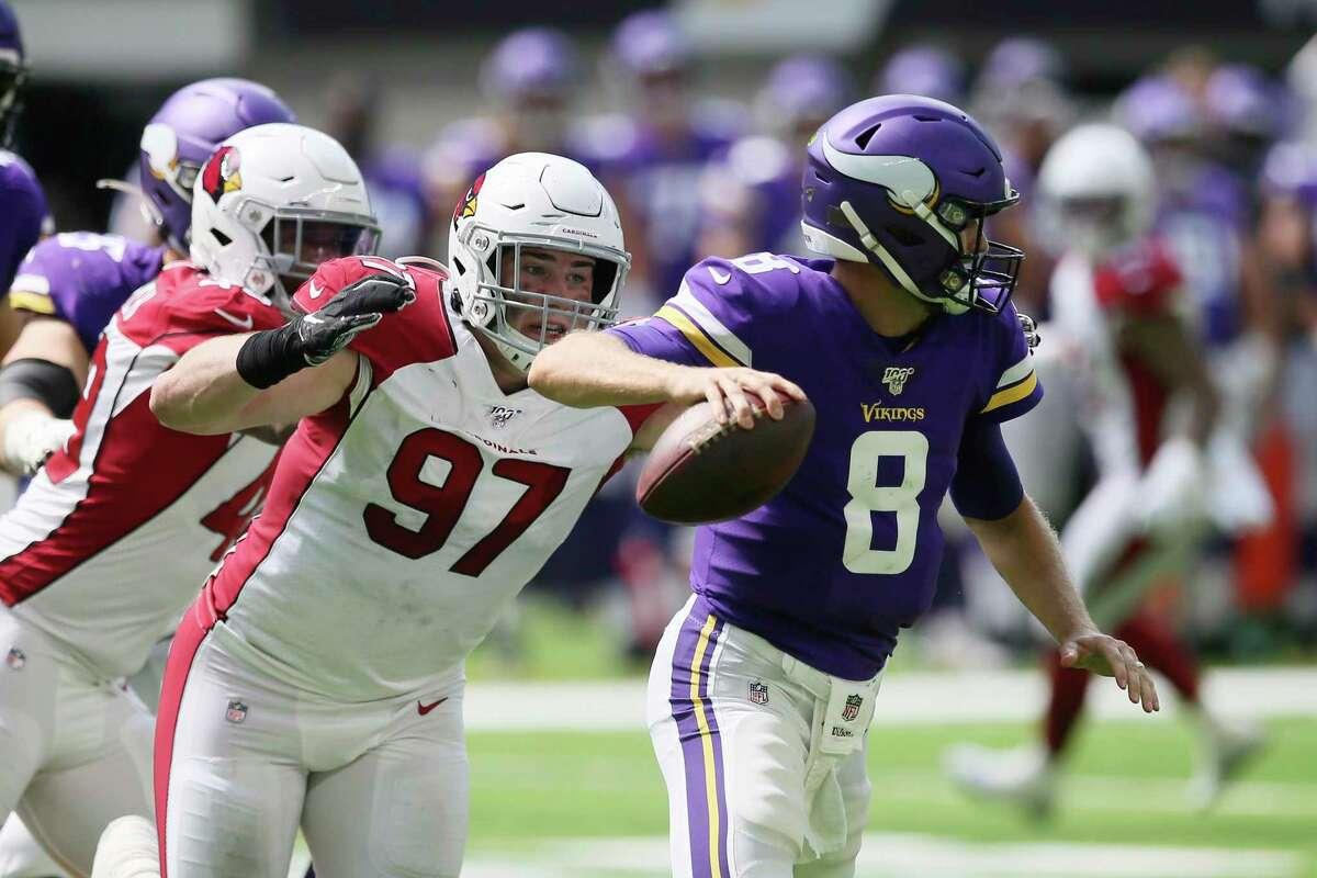Arizona Cardinals defensive end Zach Allen (97) pressures Minnesota Vikings quarterback Kirk Cousins, right, during the first half of an NFL preseason football game, Saturday, Aug. 24, 2019, in Minneapolis. (AP Photo/Jim Mone)