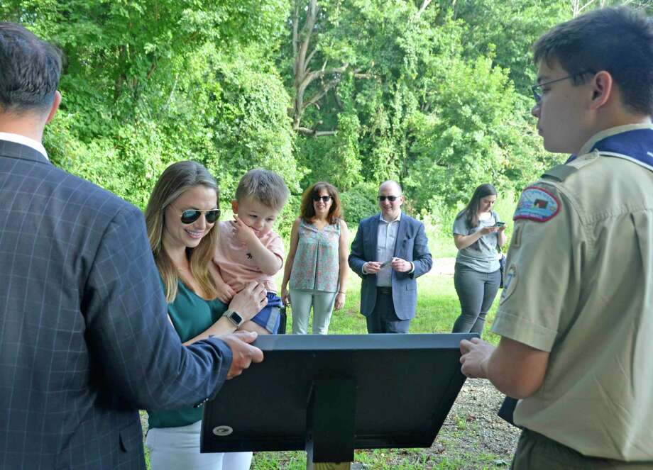 A ribbon cutting ceremony was held Saturday, Aug. 31, 2019 at Eisenhower Park for the new StoryWalk, brought to Milford by Marco Buschauer for his Eagle Scout project. Photo: Jill Dion / Hearst Connecticut Media
