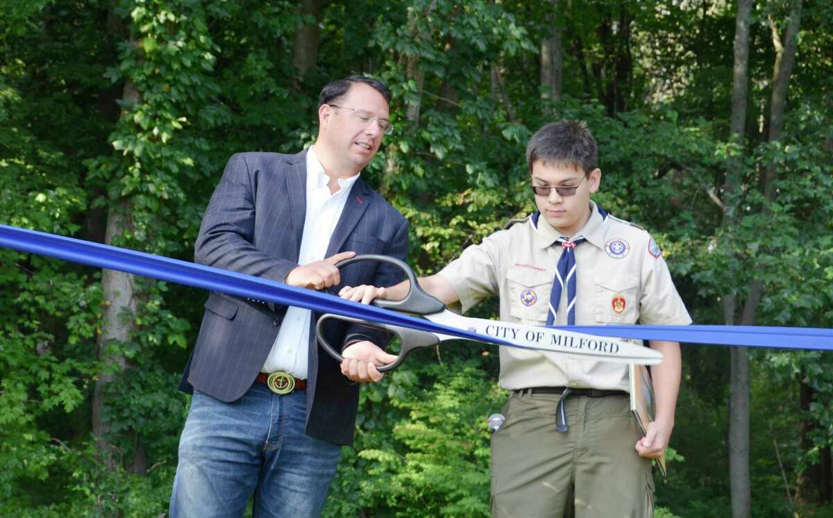 A ribbon cutting ceremony was held Saturday, Aug. 31, 2019 at Eisenhower Park for the new StoryWalk, brought to Milford by Marco Buschauer for his Eagle Scout project.