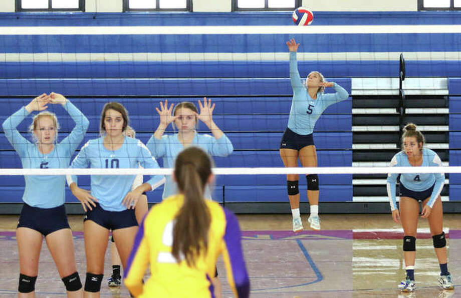Jersey's Clare Breden (5) gets off a jump serve for one of her eight aces against Civic Memorial in the championship match of the Roxana Invitational girls volleyball tournament on Saturday at Milazzo Gym in Roxana. Photo: Greg Shashack / The Telegraph