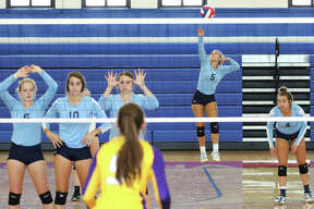 Jersey's Clare Breden (5) gets off a jump serve for one of her eight aces against Civic Memorial in the championship match of the Roxana Invitational girls volleyball tournament on Saturday at Milazzo Gym in Roxana.