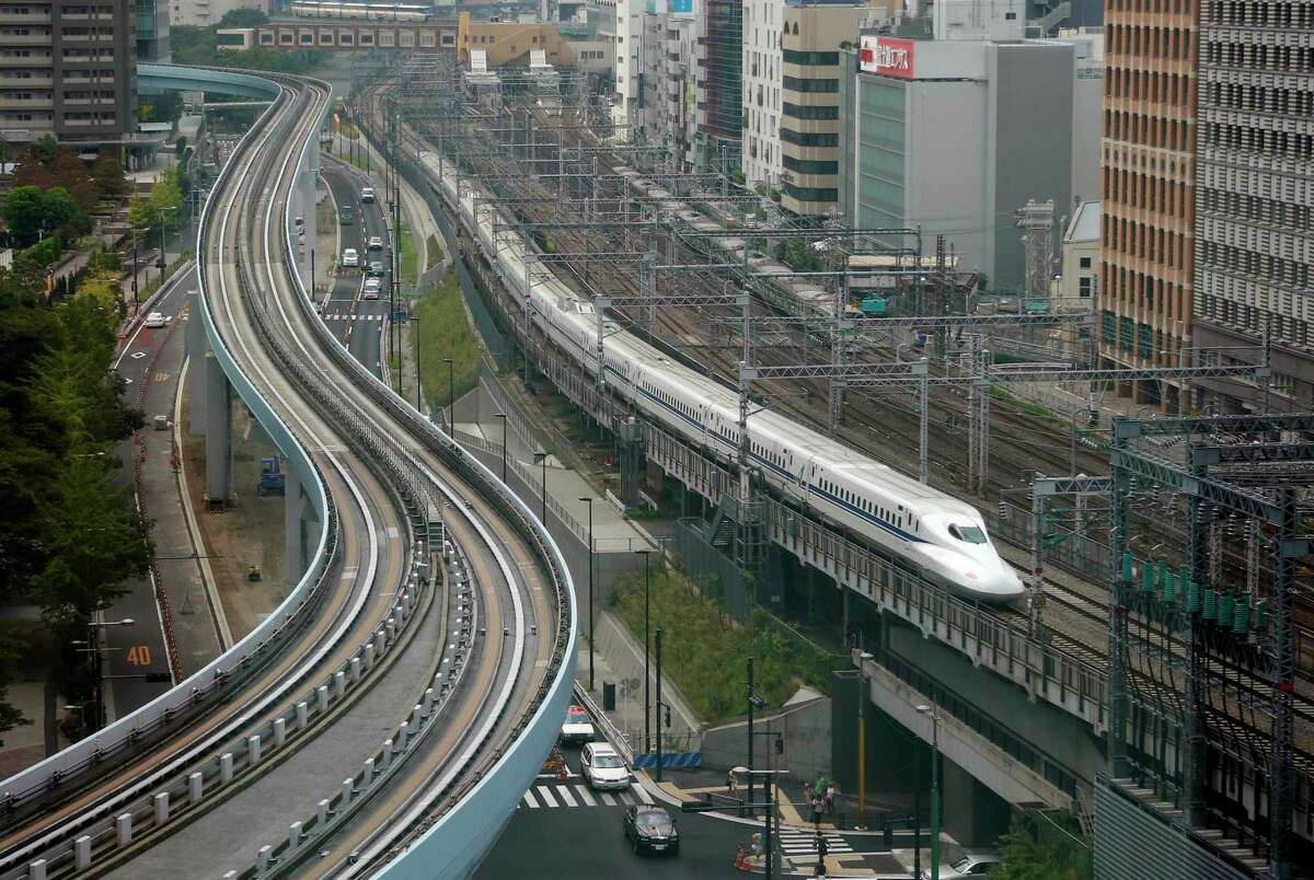 Japan has invested billions in mass transit such as the Shinkansen bullet train, above left, in Tokyo.
