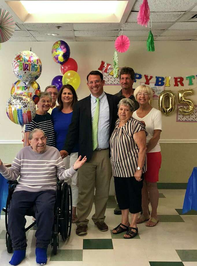 James Mottola celebrated his 105th birthday on Aug. 26, 2019 at Milford Health & Rehabilitation Center with friends, family and Milford's Mayor Benjamin Blake. Photo: Contributed Photo.