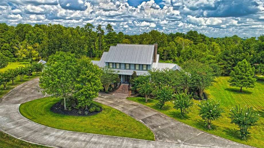 This swanky rustic ranch located 1551 E. Clayton Street in Dayton is now on the market for nearly half a million less than its original listing price. The country retreat is only an hour away from Houston and boasts 28 acres of lush greenery that make for stunning sunset views. Photo: Houston Association Of Realtors