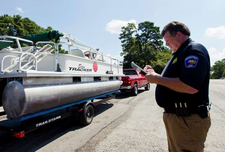 Capt. Joe Sclider, with the Precinct 1 Constable's Office, works with boaters to administers voluntary safety checks before enjoying Lake Conroe on Labor Day, Monday, Sept. 2, 2019, in Conroe. Photo: Jason Fochtman, Houston Chronicle / Staff Photographer / Houston Chronicle