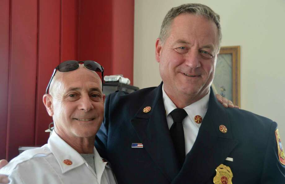 "Fire Battalion Chief Russ ""Chip"" Chapman, right, with Fire Chief Doug Edo, on the day of Chapman's retirement Aug. 30, 2019. Photo: Jill Dion / Hearst Connecticut Media"