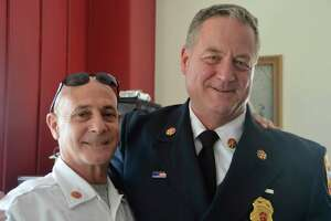 "Fire Battalion Chief Russ ""Chip"" Chapman, right, with Fire Chief Doug Edo, on the day of Chapman's retirement Aug. 30, 2019."