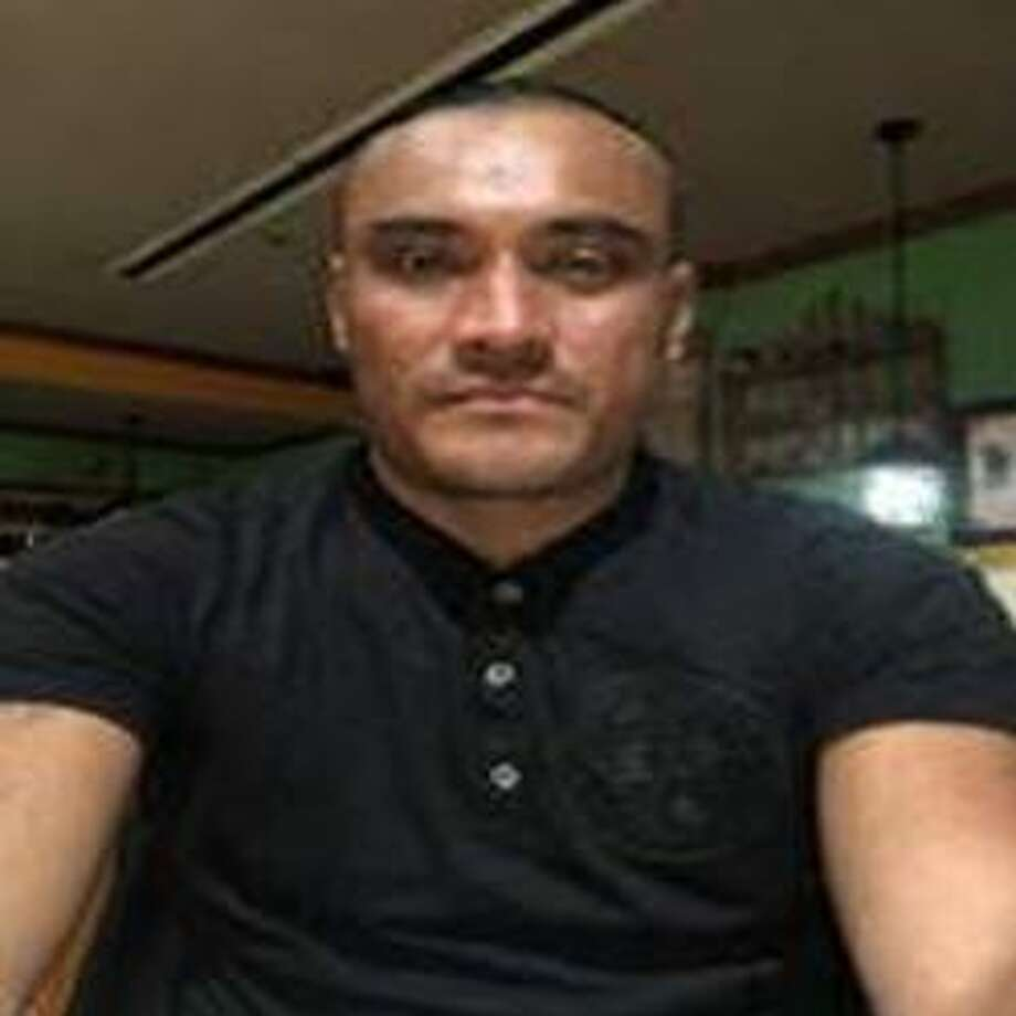 The driver of the Cadillac identified as Angel Aviles-Perez, 37, of Sealy, was last seen fleeing on foot west of the crash scene, wearing a white T-shirt and jeans. (This is the most recent photo of Aviles-Perez) Photo: Courtesy Texas DPS