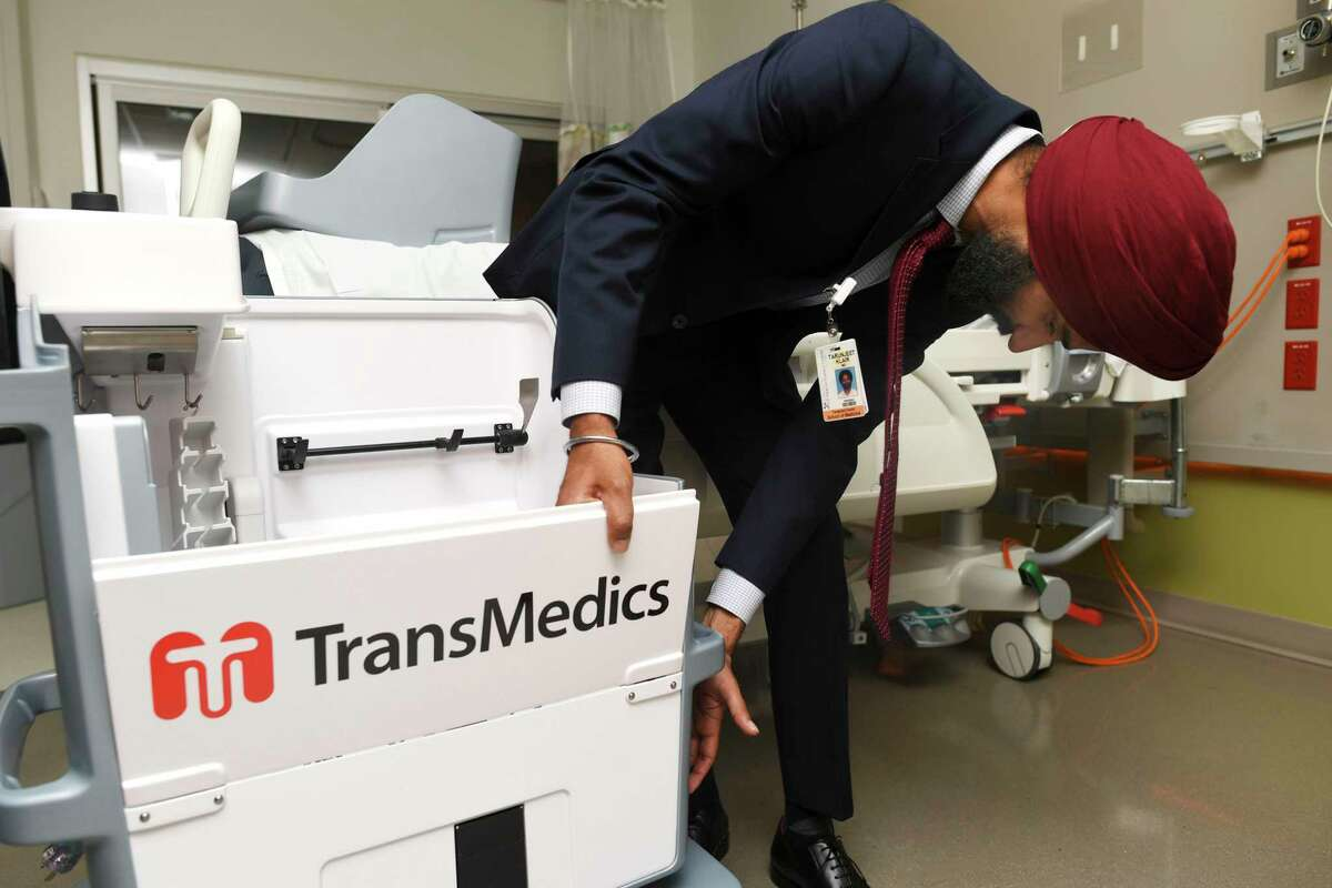 Dr. Tarunjeet Klair, surgical director of living liver donations at University Transplant Center in San Antonio, explains the workings of a machine that uses perfusion technology to help in preserving livers for transplants.