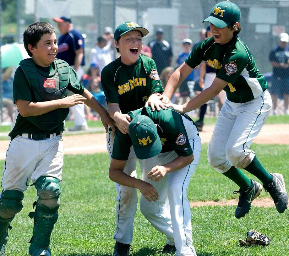 SPECTRUM/New Milford players, back row, left to right, Robert Mosso, Brendan Profita and Tim Gesualdi, celebrate with Tyler Hansen, who pitched the last three innings for the New Milford Youth Baseball/Softball 11-year-olds in the state championship game vs. Danbury. New Milford defeated Danbury, 10-6, to win the Cal Ripken 11-year-old state tournament championship July 31, 2010 at Rogers Park. Photo: Barry Horn / The News-Times Freelance