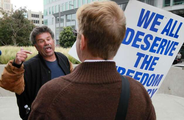 SAN FRANCISCO - AUGUST 04:  Prop 8 supporter Mark Wassberg (L) argues with Prop 8 opponent Ron Weaver as they wait to hear the ruling on Prop 8 outside of the Philip Burton Federal building  August 4, 2010 in San Francisco, California. US District Judge Vaughn Walker announced his ruling to overturn Prop 8 finding it unconstitutional. The voter approved measure denies same-sex couples the right to marry in the State of California.  (Photo by Justin Sullivan/Getty Images) *** Local Caption *** Ron Weaver;Mark Wassberg Photo: Justin Sullivan, Getty Images / 2010 Getty Images