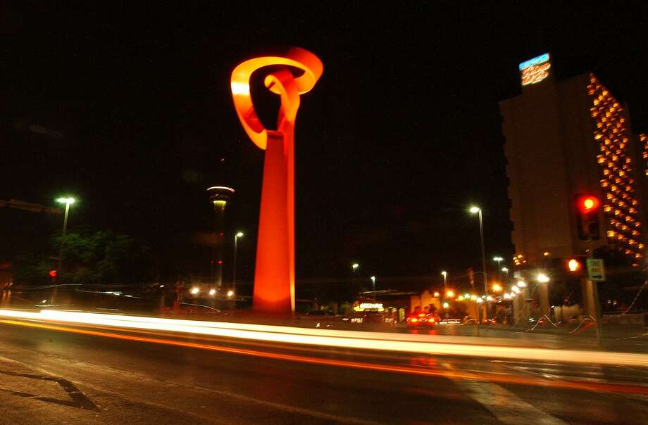 "Downtown traffic streaks past the ""Torch of Friendship,"" the Sebastian sculpture that has become a San Antonio landmark. Photo: Express-News File Photo / SAN ANTONIO EXPRESS-NEWS"