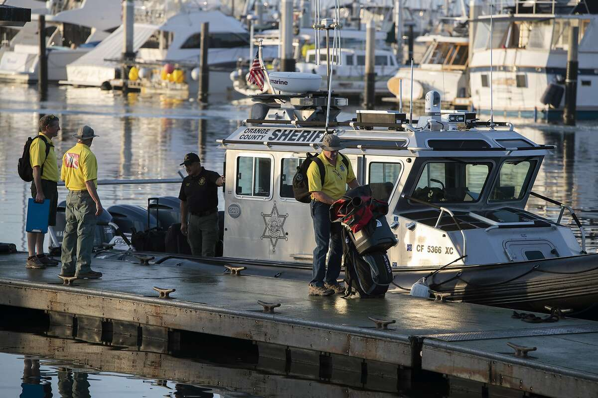 Divers with the San Luis Obispo County Sheriff's Dive Team prepare to search for missing people following a dive boat fire off Southern California's coast that killed dozens sleeping below deck, on Tuesday, Sept. 3, 2019, in Santa Barbara, Calif. (AP Photo by Christian Monterrosa )