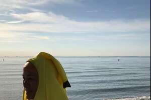 Jana Ireijo of Westport wears a banana suit at Compo Beach, in preparation for a myTeamTriumph triathlon.