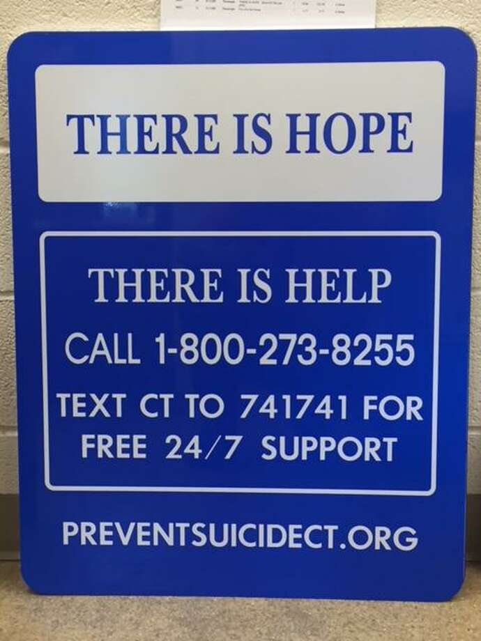 The state Department of Transportation has placed suicide prevention signs on the Arrigoni Bridge, which spans the Connecticut River, connecting Middletown and Portland. Photo: Connecticut Department Of Transportation Photo