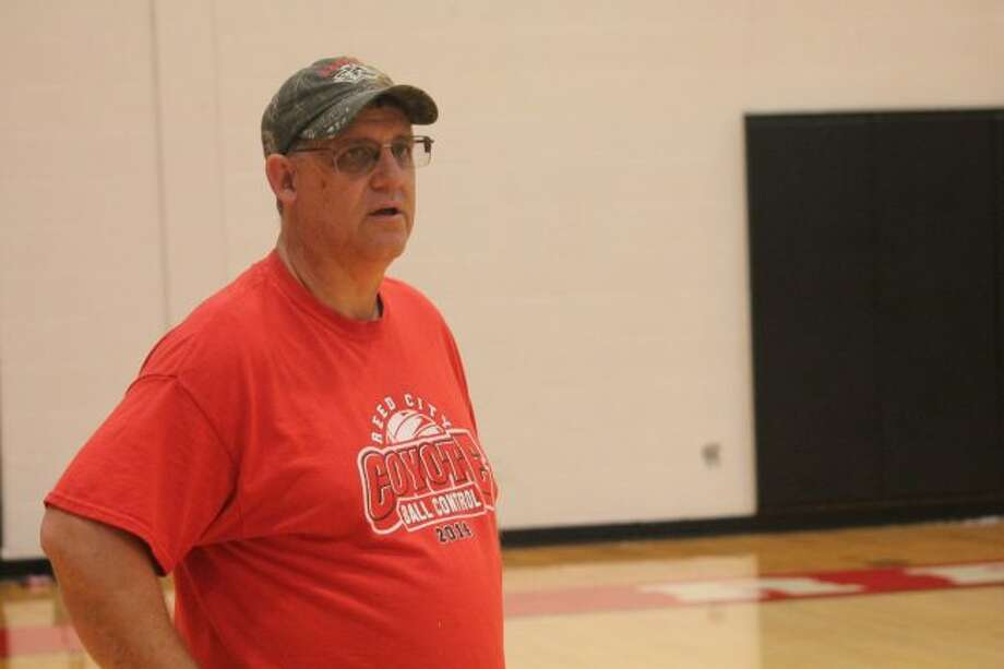 Reed City volleyball coach Don Patterson keeps an eye on the action during a recent summer practice. (Pioneer photo/John Raffel)