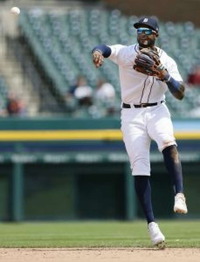Detroit Tigers second baseman Niko Goodrum throws to first base but is too late to make the out on Chicago White Sox's Leury Garcia during the sixth inning of a baseball game, Wednesday. (AP Photo/Duane Burleson)