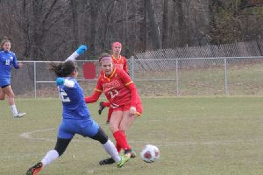 Ferris' Gabrielle Teodorescu (23) goes after the ball during NCAA soccer action last season. (Pioneer file photo)
