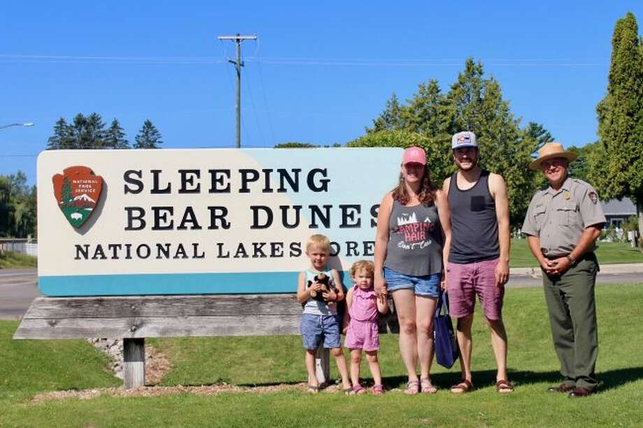 Meghan Boertman her husband Spencer and their two children, Jacoby and Levi, were greeted as the 50 millionth visitors to the Sleeping Bear National Lakeshore on Aug. 19 by Deputy Superintendent Tom Ulrich. (Courtesy Photo)