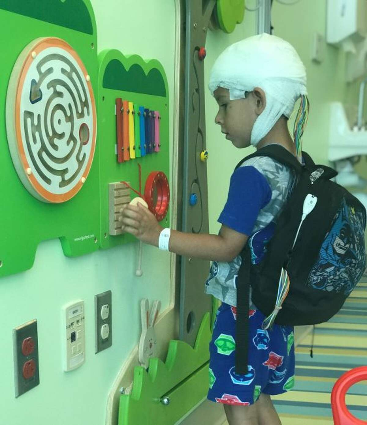 Cash Taylor, 4, plays with toys while being monitored by a new wireless epilepsy monitoring unit at Helen DeVos Children's Hospital. Taylor was one of the first patients to use the new technology.