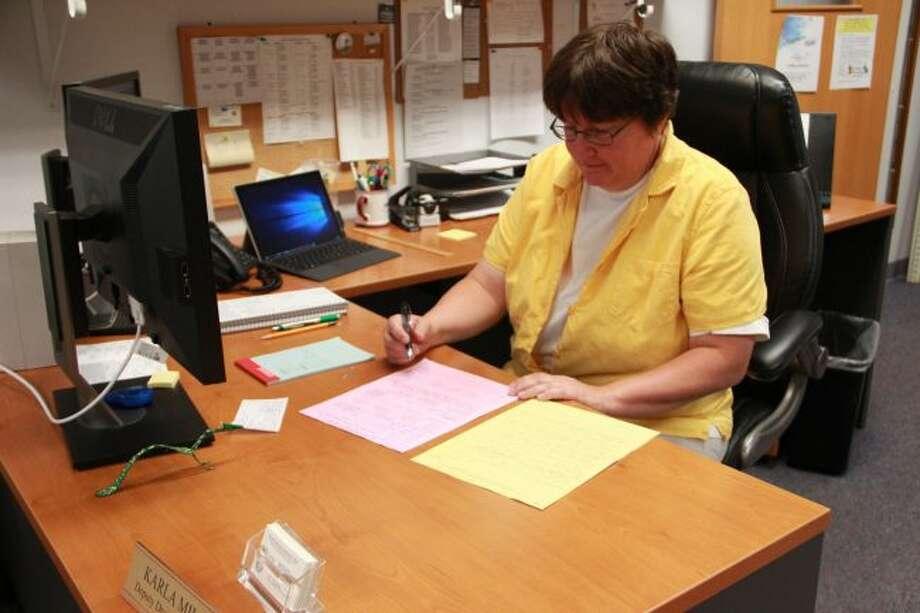 Deputy Drain Commissioner Karla Miller looks through her paperwork after spending the morning out in the field. Miller will be taking over as Drain Commissioner after Jackie Fitzgerald retires from the position at the end of September. (Pioneer photo/Alicia Jaimes)