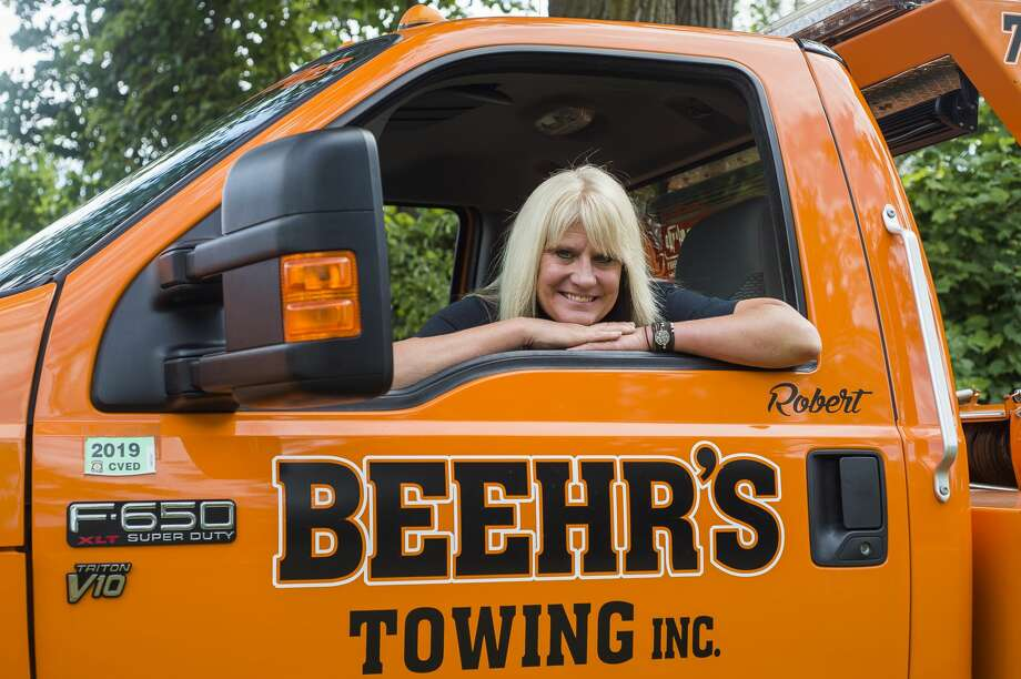 Beckie Baybeck, owner of Beehr's Towing in Midland, poses for a portrait inside one of the company's tow trucks Friday, Aug. 23, 2019 in Midland. (Katy Kildee/kkildee@mdn.net) Photo: (Katy Kildee/kkildee@mdn.net)
