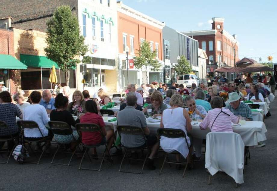 Members of the Big Rapids area community ventured into downtown Big Rapids Friday evening to enjoy a meal while supporting those in need at Manna Pantry's third annual Share the Harvest dinner. The locally sourced meal was prepared by several area chefs. (Pioneer photo/Taylor Fussman)
