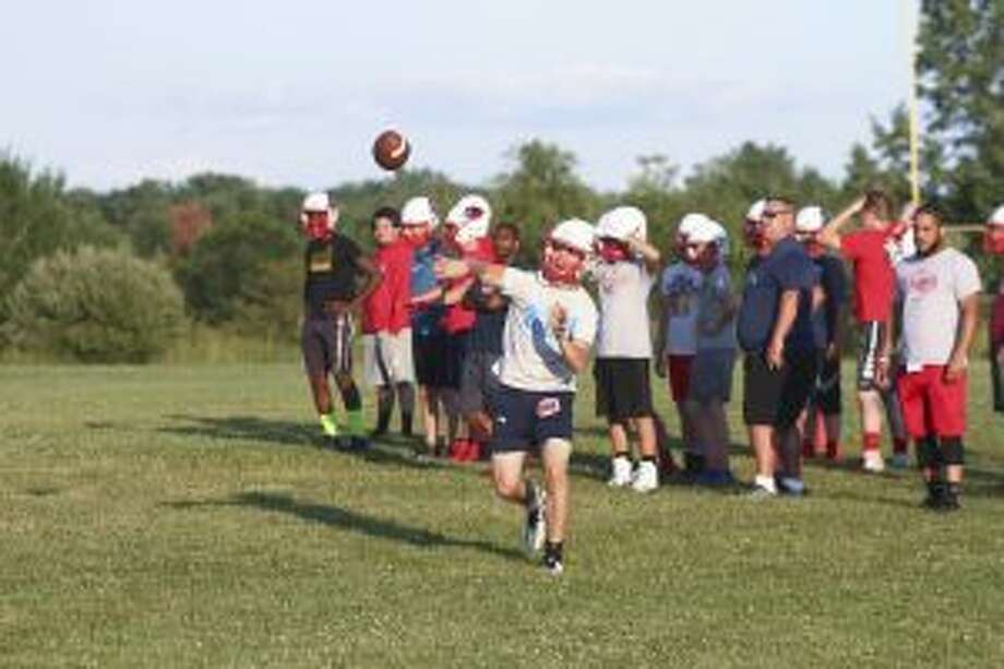 Big Rapids junior Sam Alley attempts a pass during team earlier this summer. Alley is one of three Cardinals competing for the starting quarterback job. (Pioneer photo/Maxwell Harden)