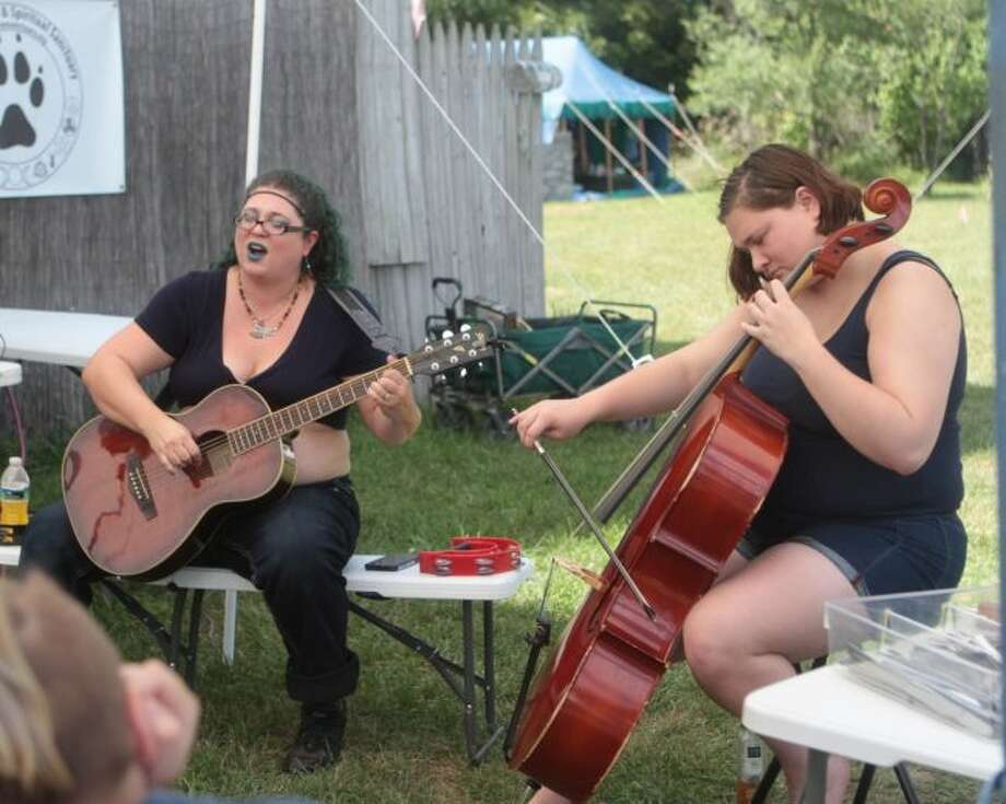 Bell Book and Canto performed at the 14th annual Wolf Run Harvest Festival and Psychic Fair Saturday afternoon. The weekend was filled with a variety of musical and spiritual performances. (Pioneer photos/Taylor Fussman)