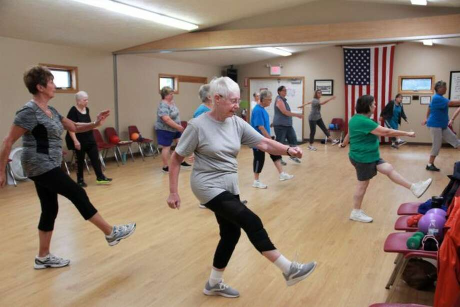 People are stepping to the beat at the 8:30 a.m. Enhance Fitness class. This class is to help people 58 or older continue to live a healthy lifestyle. (Pioneer photo/Alicia Jaimes)