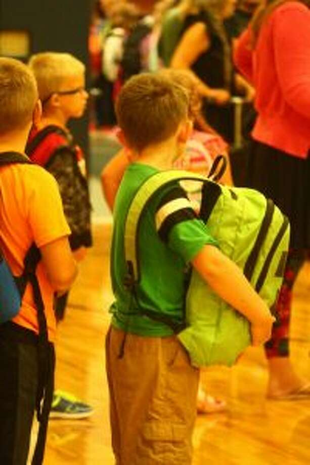 At 8:15 a.m. on Tuesday, students headed to the gym to meet their new teacher and classmates. (Pioneer photo/ Catherine Sweeney)