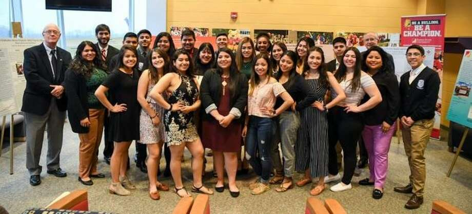 The 2018-19 Promesa Scholars Program cohort stands with FSU provost Paul Blake (left) and president David Eisler (back right). The program was recognized by Excelencia in Education for promoting Latino success in higher education. (Courtesy photo)