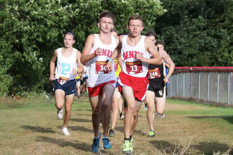 Tyler Kintigh (left) and Hunter Jones (right) lead the boys field in the Trails and Bails 2 Miler on Aug. 29. (Photo/Robert Myers)