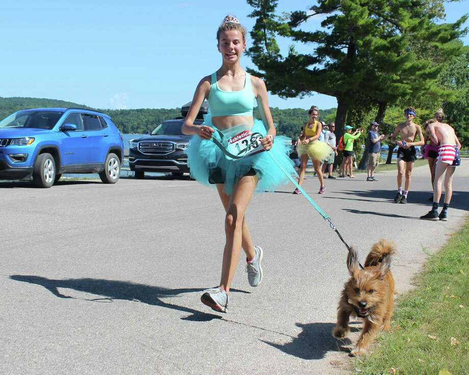 Some teams had fun running in costumes or even with a canine friend.
