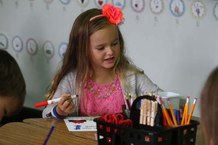 New kindergartners started their morning at kinder-camp by practicing their drawing skills. Later in the day, they worked on other activities intended to prepare them for the school year. (Pioneer photo/ Catherine Sweeney)