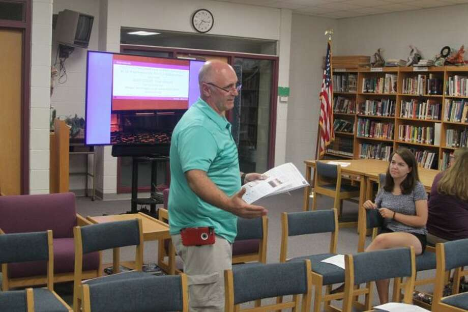 Brethren teacher Bill Cunningham explains to the Kaleva Norman Dickson Board of Education the Code.org professional learning training he and teachers Mitch Knoll and John Prokes recently received to become certified. This year both Brethren and Bear Lake schools will be offing coding classes as a result of the training.