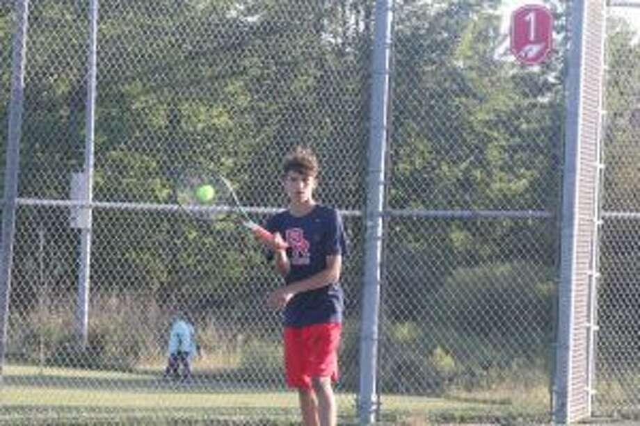 Owen Westerkamp plays the ball.
