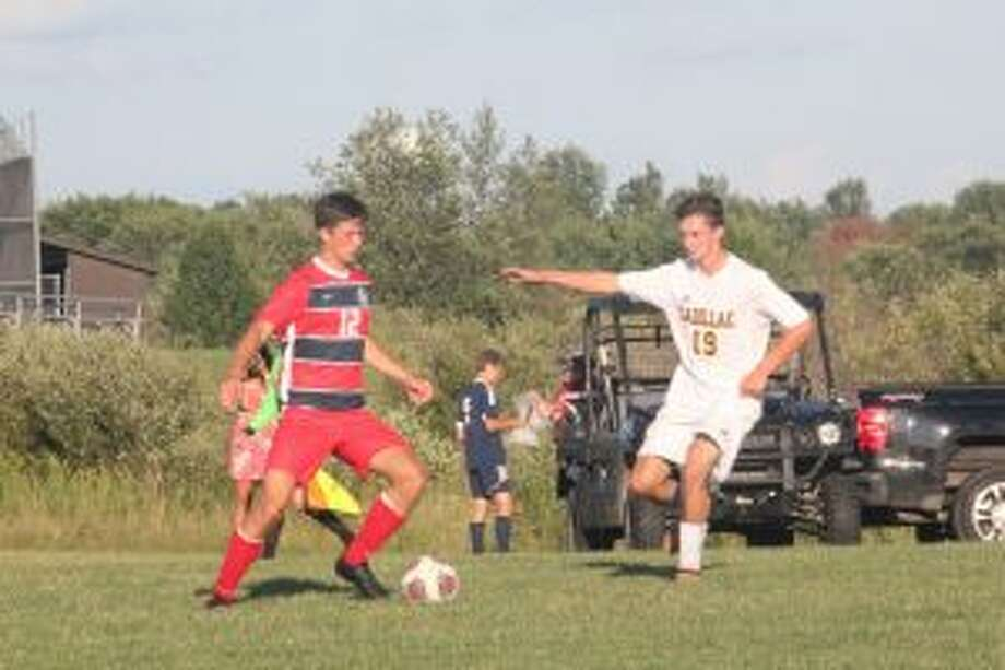 Jackson Rogers (12) works with the ball for Big Rapids