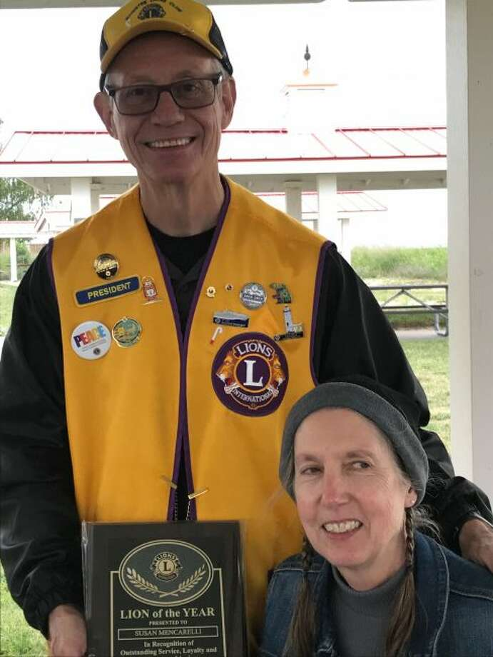 Manistee Lions Club president Michael Szymanski presents Susan Mencarelli with plaque for being named the Manistee Lions Club Lion of the Year. Mencarelli serves as the club secretary and member of the board. She has been instrumental in most of the Lions Club charity, social and community events. In addition, Mencarelli is involved in several other programs benefiting the community. (Courtesy photo)